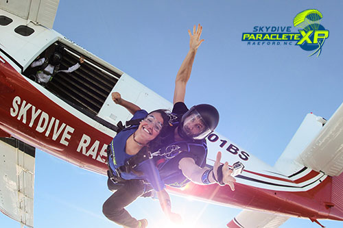 girl tandem skydiving near Raleigh