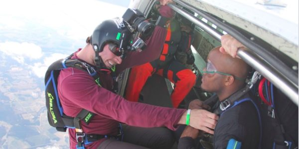 Instructor and tandem skydiving prepare for jump