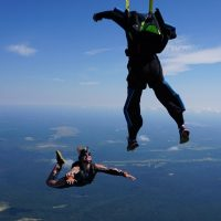 student deploys parachute during learn to skydive course