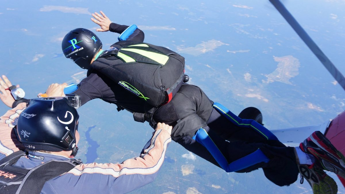 instructor guides learn to skydive student through exit and freefall