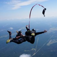 student deploys their own parachute during skydiving course