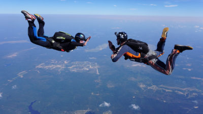 During a skydive, hand signals are used... you can't speak to each other during free fall.