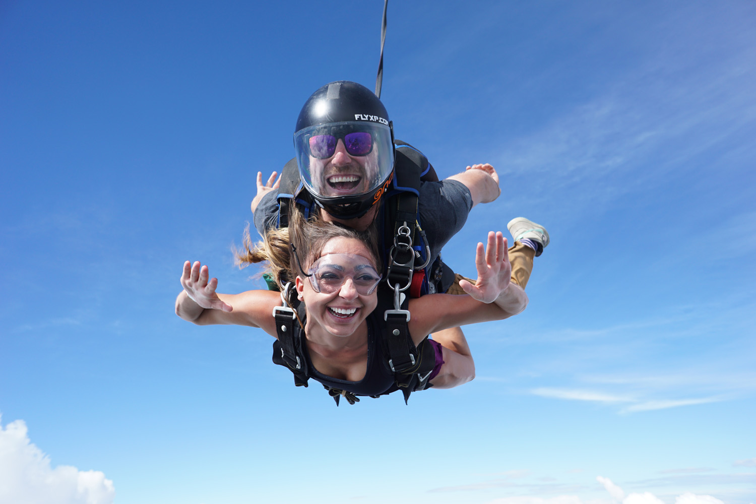These are two people skydiving.