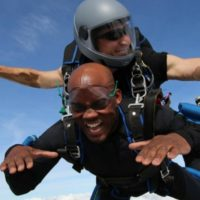 young man makes a tandem skydive