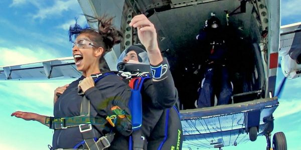 exit shot of woman tandem skydiving near Fayetteville