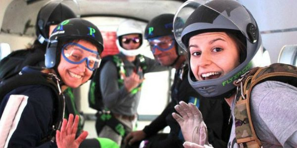 inside of a skydiving plane full of jumpers