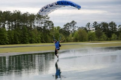 experienced skydiver lands into swoop pond