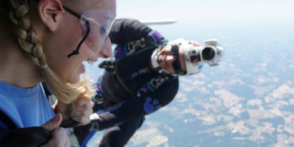 girl weighs skydiving risks before jumping