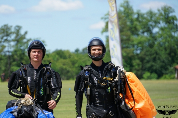 experienced jumpers after skydiving landing