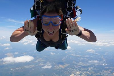 first time skydiver with writing on her hands