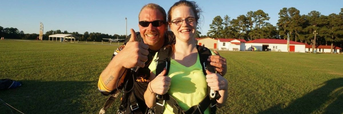 Heather Wolfe gives a thumbs up after landing from a skydive