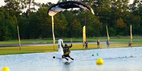 competitor makes swooping landing skydiving
