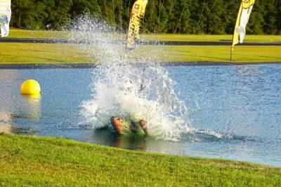 skydiver makes a splash during swooping skydiving landing