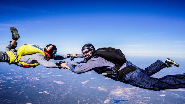Skydivers in free fall during a-license certification