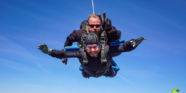 A tandem student smiling while making a tandem skydive