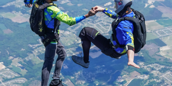 Two skydiver flying through the air.