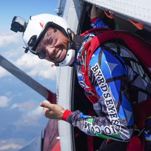 A skydiver prepares to jump.