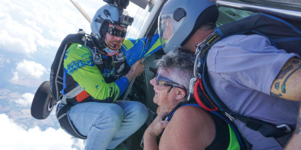 A skydiver prepares to jump from the plane.