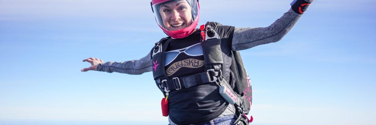 A skydiver falls through the air.